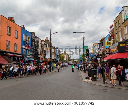 LONDON, UK - 19TH JULY 2015: Large amounts of people along Camden High Street during the day on a weekend - stock photo