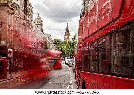 LONDON, UK - 28TH JUNE 2016: A view along Whitehall Street in London during the day towards Big Ben and Elizabeth Tower. London Buses can be seen. - stock photo