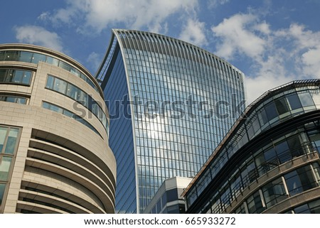 LONDON UK - 19TH JUNE 2017; Looking up at the '20 Fenchurch Street' skyscraper in the 'City of London' against blue skies