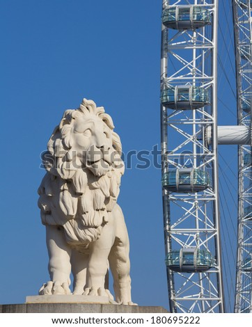 LONDON, UK - 9TH MARCH 2014: A Lion sculture in front of the London Eye Attraction during the day - stock photo