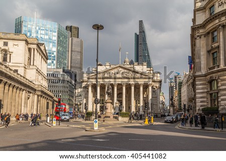 LONDON, UK - 25TH MARCH 2015:  The Bank of England in the City of London showing buildings, people and traffic - stock photo