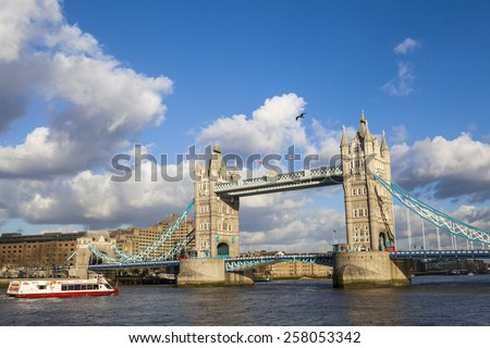 LONDON, UK - 4TH MARCH 2015: The beautiful view of Tower Bridge in London with a City Cruise boat on 4th March 2015. - stock photo