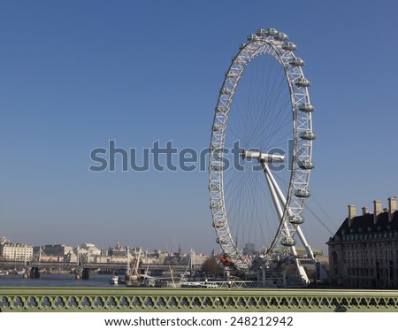 LONDON, UK - 9TH MARCH 2014: The London Eye from Westminster Bridge on a clear day - stock photo