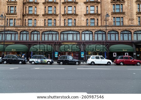 LONDON, UK - 9TH MARCH 2015: Various coloured taxis in central London outside Harrods - stock photo