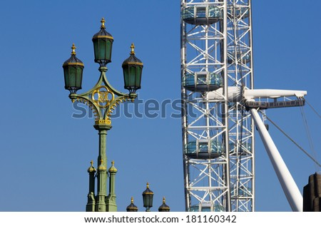 LONDON, UK - 9TH MARCH 2014: Westminster Street Lamps with the London Eye in the Background - stock photo