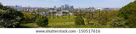 LONDON, UK - 26TH MAY 2013: A panoramic shot taken from the Greenwich Observatory in London.  The view takes in sights such as Docklands, the Royal Naval College, Millennium Dome and the River Thames. - stock photo