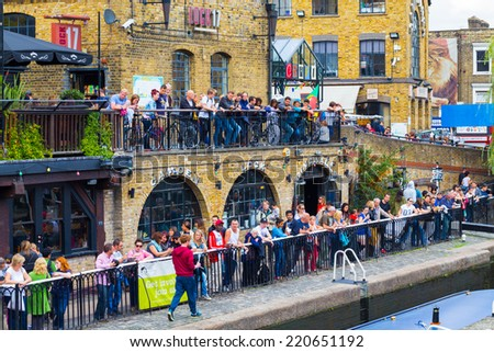 LONDON, UK - 27TH SEPTEMBER 2014: Lots of people along the lake at Camden Lock during the day - stock photo
