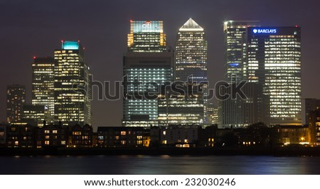 LONDON, UK - 24TH SEPTEMBER 2014: The outside of Canary Wharf from across the River Thames at night - stock photo