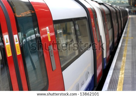 London Under ground or tube train in a station at Stratford, London. - stock photo