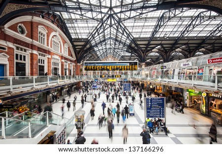 LONDON, UNITED KINGDOM - APRIL 9: Commuters inside Liverpool Street Station on April 9, 2013 in London, UK. The annual rail passenger usage between 2011 - 2012 was 13.835 million. - stock photo