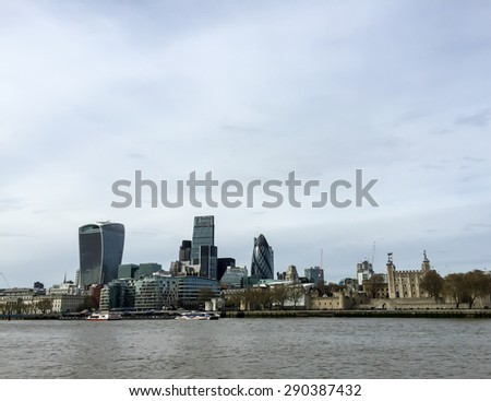 LONDON, UNITED KINGDOM - APRIL 18, 2015: Landscape of London skyscrapers with Thames river.  London is the world's leading financial centre for international business and commerce. - stock photo