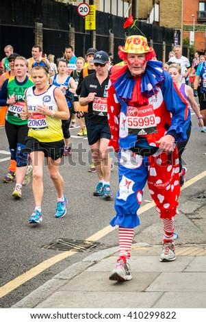 London, United Kingdom - April 24, 2016: London Marathon 2016. Runners in great costumes. Clown costume - stock photo