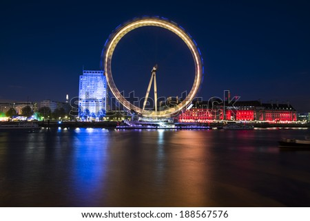 London, United Kingdom - April 18, 2014: London, UK, skyline at night. London Eye is Europe's tallest Ferris wheel and the most popular paid tourist attraction in UK  - stock photo
