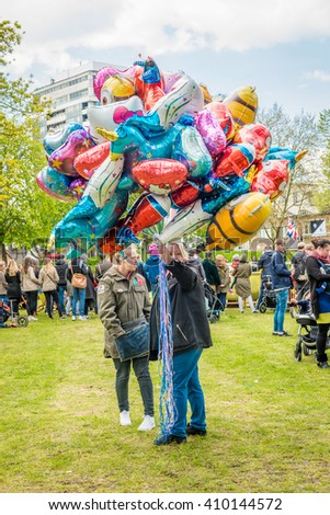 London, United Kingdom - April 23, 2016: St Georges day celebration at  Vauxhall Pleasure Gardens. Bunch of balloons on sale