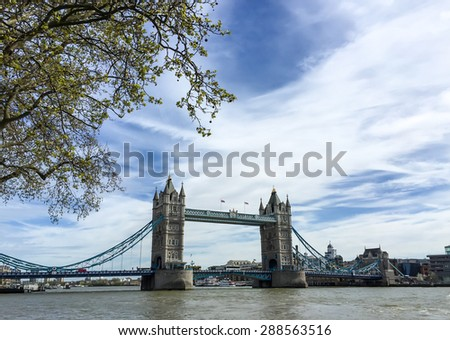 LONDON, UNITED KINGDOM - APRIL 18, 2015: The famous London landmark, The Tower Bridge across Thames river with blue sky. London is the world's most-visited city as measured by international arrivals. - stock photo