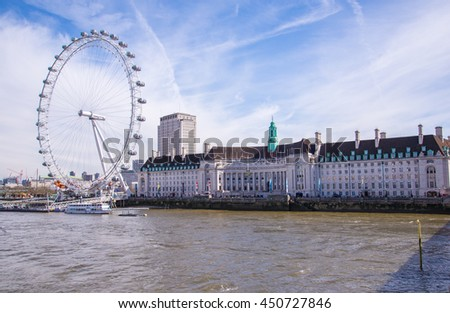 LONDON, UNITED KINGDOM - 11 APRIL,2016: The London Eye on the South Bank of the River Thames at sunset n London, England on 11 April 2016. - stock photo