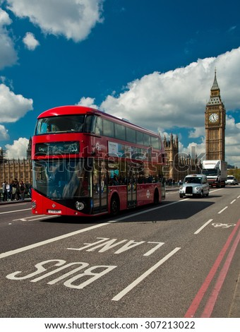 LONDON, UNITED KINGDOM - 26 APRIL, 2015: Typical red bus and black taxi in London, United Kingdom on 26 April, 2015. - stock photo