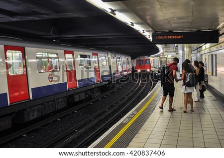 London, United Kingdom - August 23, 2009: Westbound train to Ealing Broadway approaching Monument tube station. - stock photo