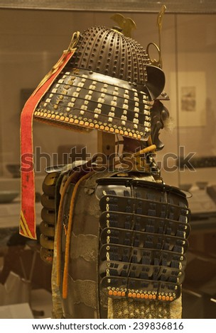 LONDON, UNITED KINGDOM - 12 DECEMBER, 2014: Samurai armour and helmet in the British Museum, London on 12 December, 2014. The armour is a collection of different pieces made between 1500 and 1800.