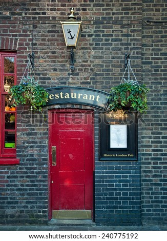 LONDON, UNITED KINGDOM - 13 DECEMBER, 2014: Typical British pub in London, United Kingdom on 13 December, 2014. Pub business in the UK has been declining every year. - stock photo