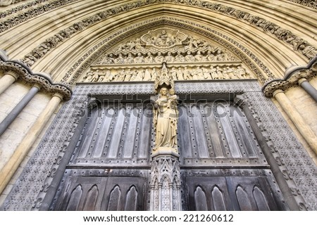 London, United Kingdom - famous Westminster Abbey church door. UNESCO World Heritage Site. - stock photo