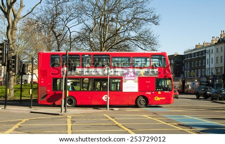 LONDON, UNITED KINGDOM - FEBRUARY 16, 2014: Red double-decker bus in London on February 16, 2014, UK. The London Bus is one of London's principal icons - stock photo