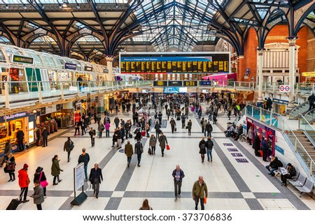 LONDON, UNITED KINGDOM - JANUARY 12, 2016: People at Liverpool Street station - opened in 1874 it is third busiest and one of the main railway stations in UK, with connection to London Underground. - stock photo