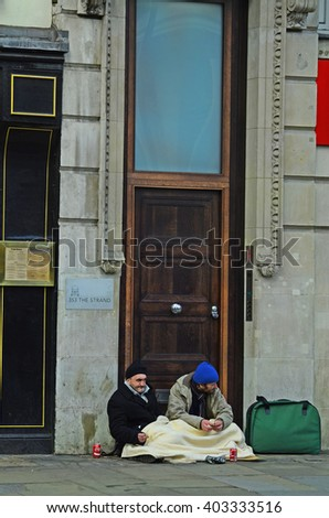 LONDON, UNITED KINGDOM - JANUARY 16: Unidentified homeless men on pavement of The Strand street, on January 16, 2016 in London, England