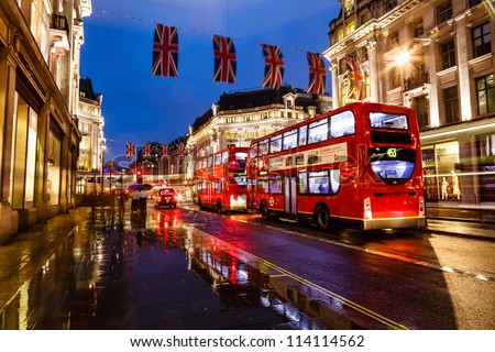 LONDON, UNITED KINGDOM - JUNE 9: A Red Bus on the Rainy Street of London on June 9, 2012 in London, United Kingdom. - stock photo