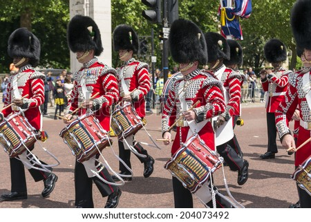 LONDON, UNITED KINGDOM - JUNE 5, 2014: British guardsmen march down the Mall in London - outside Buckingham Palace.  - stock photo