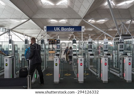 LONDON, UNITED KINGDOM - JUNE 2015: Electronic automatic passport check at UK border in Stansted airport. It was the 4th busiest airport in the UK with 17.4 million passengers. - stock photo