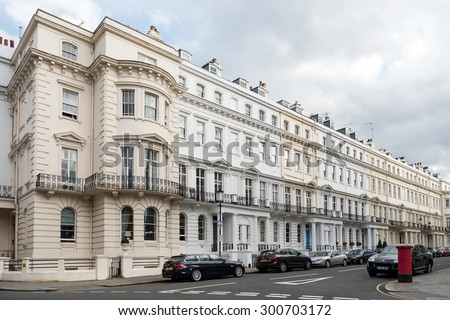 LONDON, UNITED KINGDOM - JUNE 21, 2015: Elegant building in Notting Hill. Notting Hill is known for hosting the annual Carnival and being home to the Portobello Road Market. - stock photo
