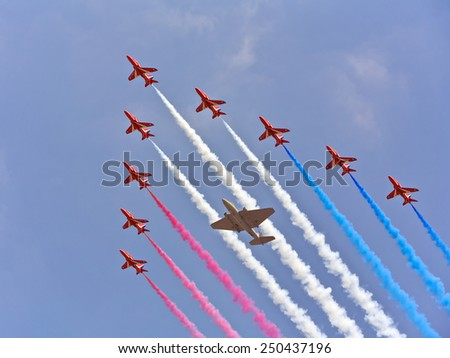 LONDON, UNITED KINGDOM - JUNE 17:  Red Arrows performing at the Buckingham Palace, Trooping of the Color. Synchronized teamwork, flying in formations,  June 17, 2006 in London, United Kingdom - stock photo