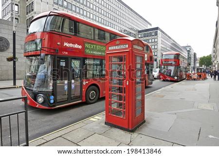 LONDON, UNITED KINGDOM - JUNE 7: Red Vintage Phone cabine and bus in London on  June 7, 2014 in London, United Kingdom - stock photo