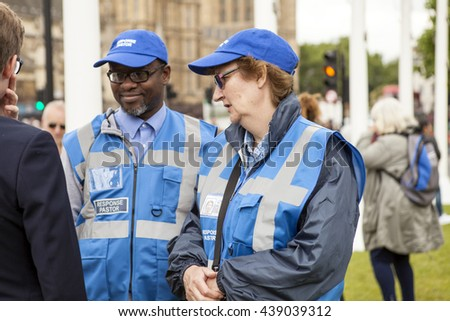 London, United Kingdom - June 18, 2016: Street Pastor. A group of Street Pastors were helping out at the Jo Cox vigil. The murder of the British MP has left a nation in shock.