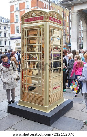 LONDON, UNITED KINGDOM - JUNE 23: Telephone booth in London on JUNE 23, 2012. Ted Baker Phone Box to celebrate ChildLine 25th anniversary at Covent Garden in London,  United Kingdom. - stock photo