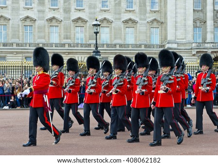 London, United Kingdom - March 31, 2016: The Royal Guards parade at the Changing of the Guards ceremony across Buckingham Palace, London. People gathered here at 11 AM to see flamboyant attraction. - stock photo