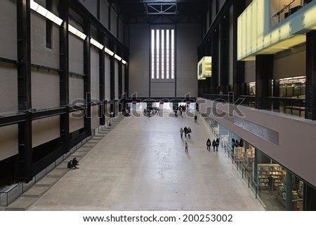 LONDON, UNITED KINGDOM - MARCH 24: The Turbine Hall in Tate Modern Art Gallery on March 24, 2014 in London. Tate Modern, Britain's national gallery of modern art, is based in former power station.