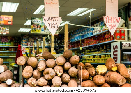 London, United Kingdom - May 14, 2016: Brixton Village and Brixton Station Road Market. Colorful and multicultural community market run by local traders in South London. White yum and yellow yum