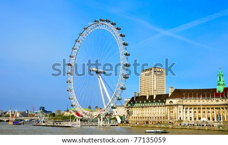 LONDON, UNITED KINGDOM - MAY 6: London Eye on May 6, 2011 in London, United Kingdom is the tallest Ferris wheel in Europe at 135 meters. - stock photo