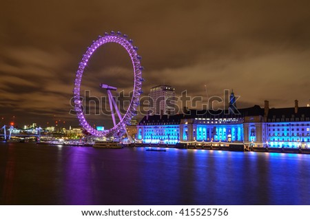 London, United Kingdom - May 05, 2016 : The London Eye is a giant wheel on the River Thames in London. The structure is 443 feet (135 m) tall and the wheel has a diameter of 394 feet (120 m).  - stock photo