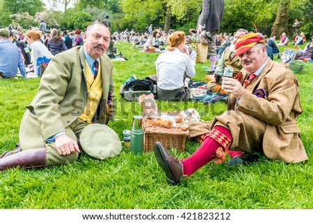 London, United Kingdom - May 14, 2016: Tweed Run (bicycle ride with a style) at picnic near Albert Memorial in Kensington Gardens, Hyde Park.