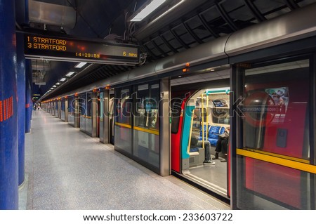 LONDON, UNITED KINGDOM - NOVEMBER 8, 2014: Jubilee line train at modern North Greenwich station. The Jubilee line is the newest line on the network. - stock photo