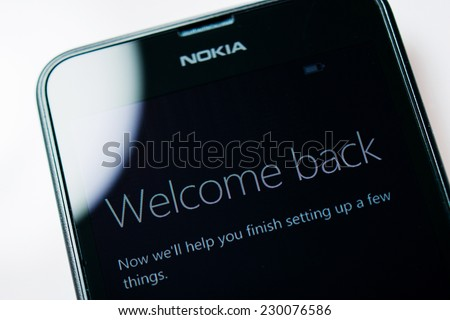 LONDON, UNITED KINGDOM - NOVEMBER 9, 2014: Nokia Lumia Windowsphone smartphone display with Welcome Back text. Microsoft has announced that it will stop using Nokia branding - stock photo