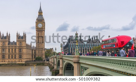 LONDON, UNITED KINGDOM-18 OCT 2016: Big Ben and Houses of Parliament during cloudy day taken from busy Westminster Bridge beside the River Thames.