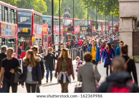 LONDON, UNITED KINGDOM - OCTOBER 25: Crowded Palace of Whitehall Street with many red double-decker buses  on October 25, 2013 in London, United Kingdom. - stock photo