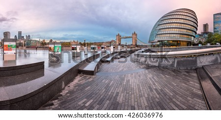 LONDON, UNITED KINGDOM - OCTOBER 7, 2014: London City Hall and Tower Bridge in London, UK. The City Hall has an unusual, bulbous shape, was designed by Norman Foster and opened in July 2002.