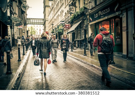 LONDON, UNITED KINGDOM - OCTOBER 14, 2014:  Street scene in the Charing Cross district of London with people visible. - stock photo