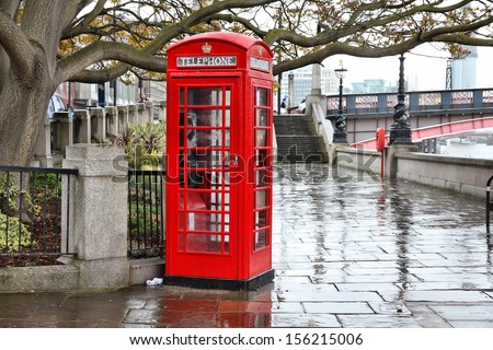 London, United Kingdom - red telephone box in the rain. HDR image. - stock photo
