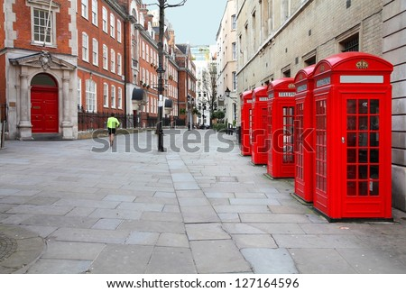 London, United Kingdom - red telephone boxes of Broad Court, Covent Garden. - stock photo